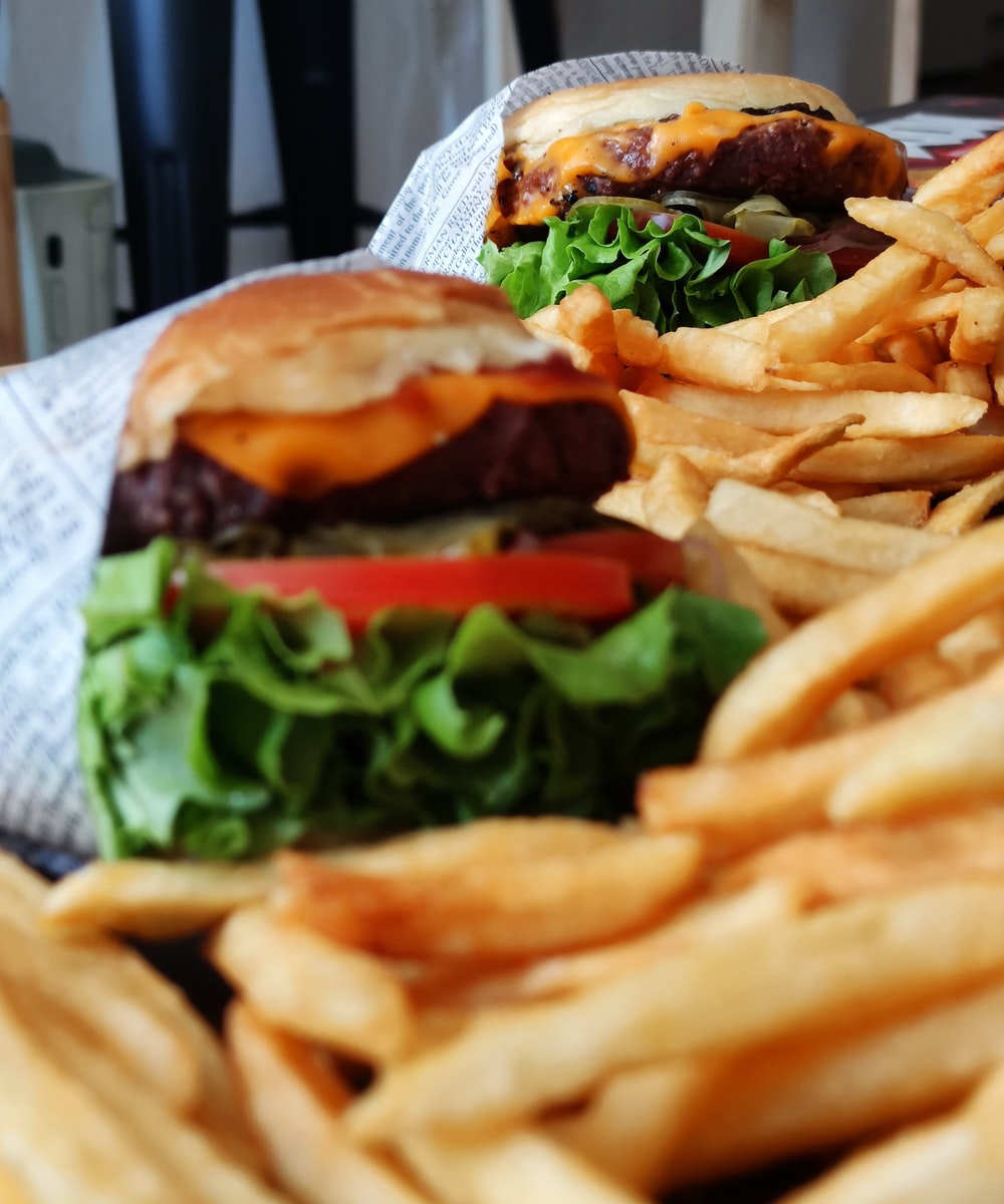 burger and fries on white paper