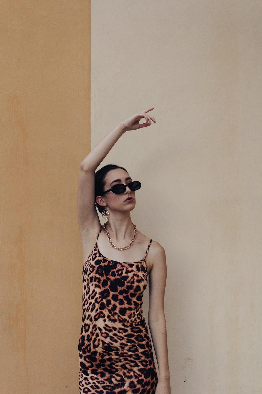 woman in black and white polka dot tank top wearing black sunglasses