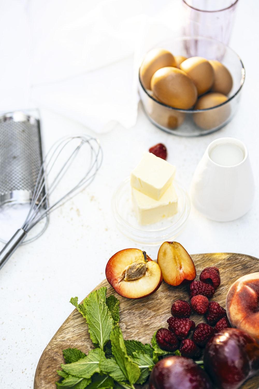 sliced apple fruit on white ceramic plate beside stainless steel fork and knife