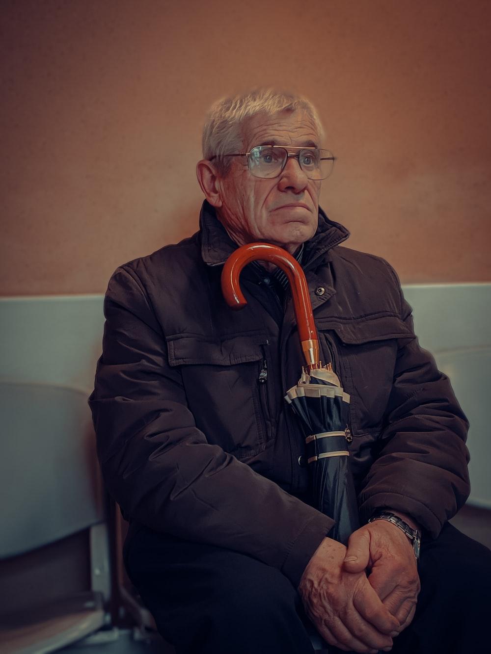 man in black jacket wearing eyeglasses