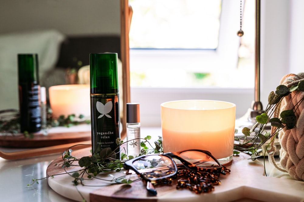 black and green labeled bottle on brown wooden table