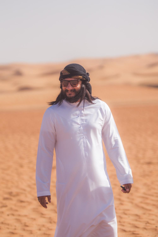 man in white long sleeve shirt wearing black sunglasses