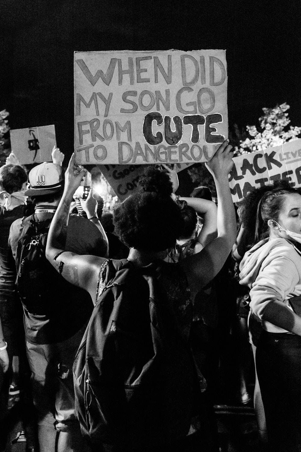 grayscale photo of people holding love you signage