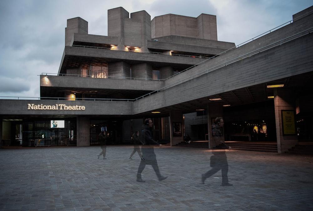 people walking on gray concrete floor during daytime