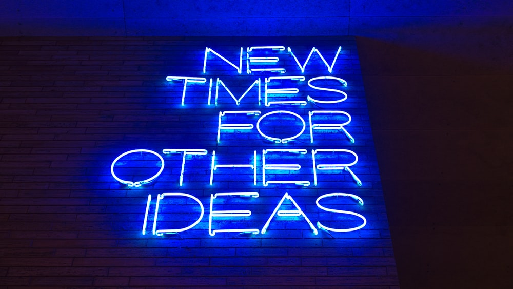 blue and white happy new year neon light signage