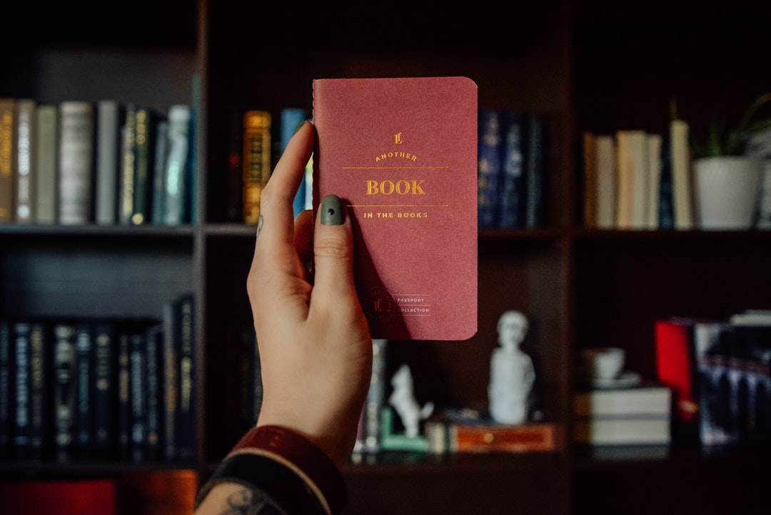 Person Holding Red and Brown Book - unsplash