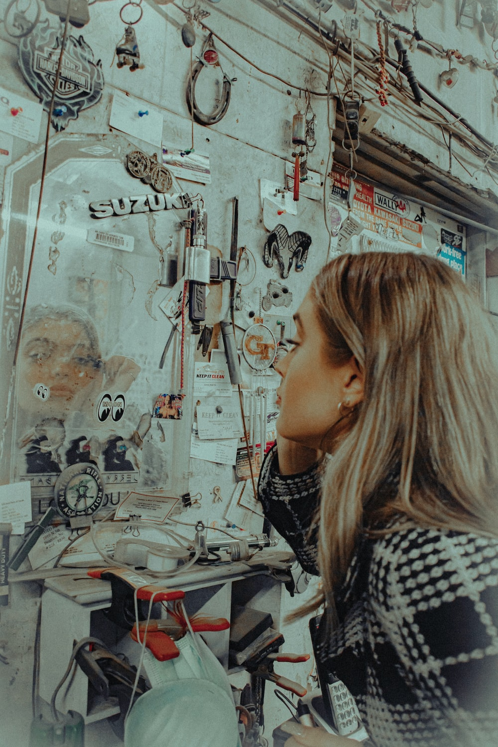 woman in black and white shirt standing near wall with graffiti