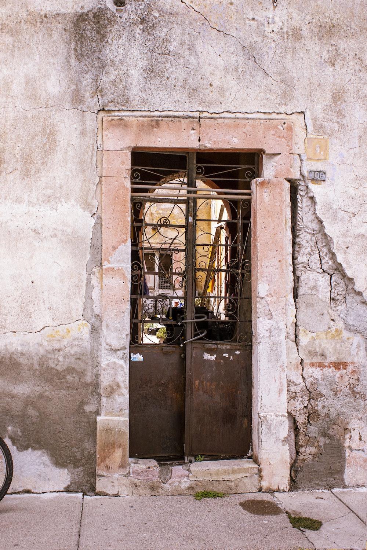 brown wooden door with brown metal door