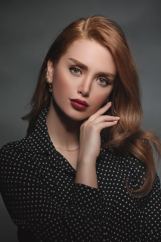 woman in black and white polka dot shirt