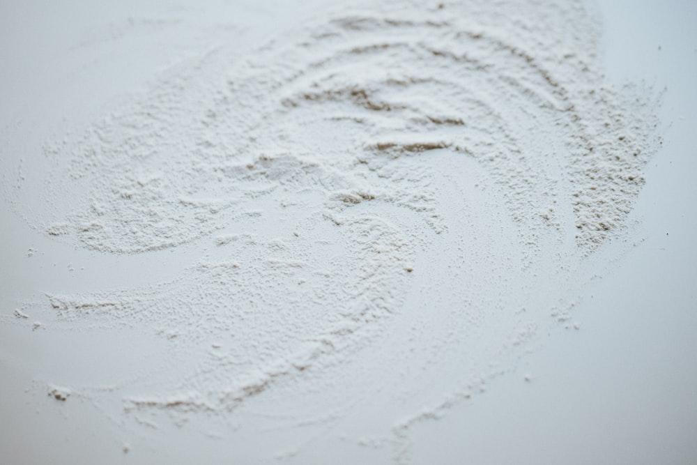 white snow on brown soil