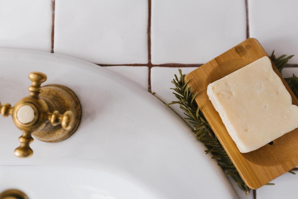 gold round ornament on white ceramic sink
