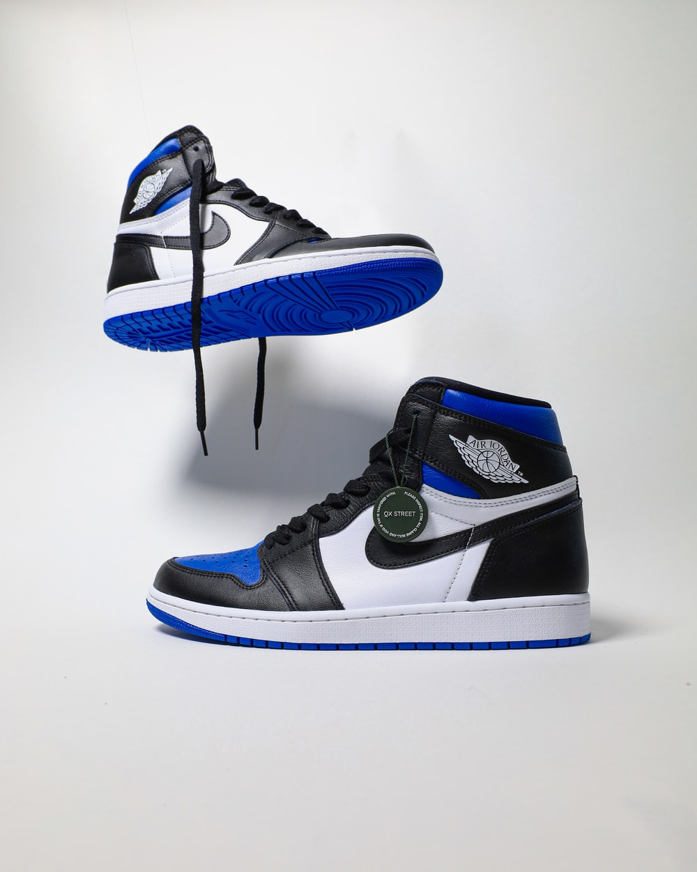 blue and black nike high top sneakers