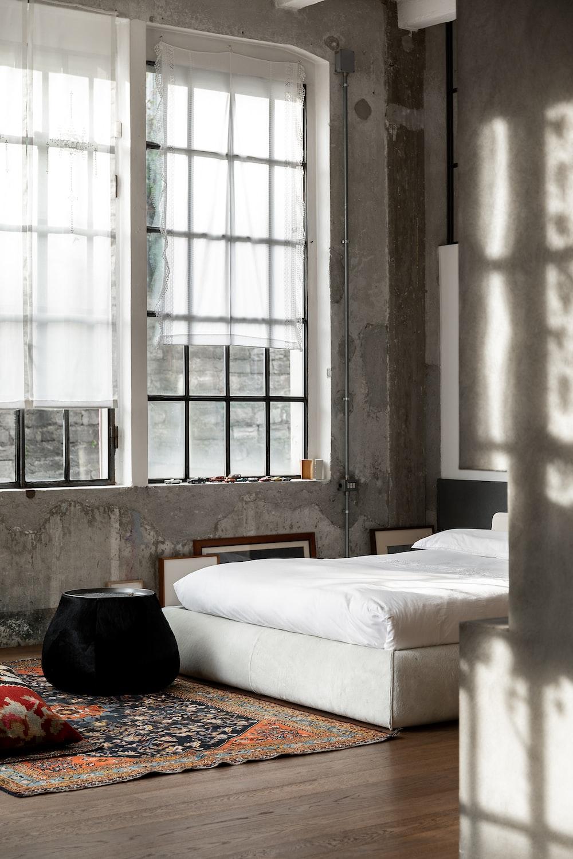 white bed near white window