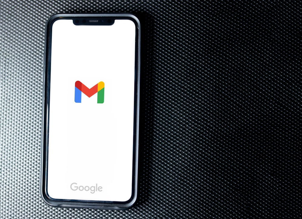 black samsung android smartphone on black textile