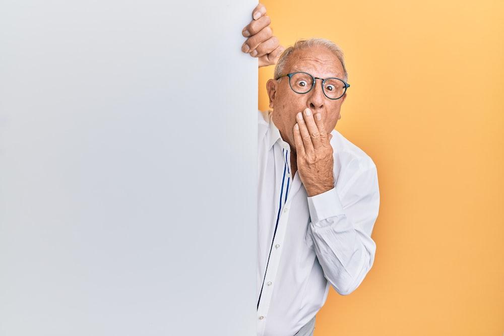 man in white dress shirt wearing black framed eyeglasses