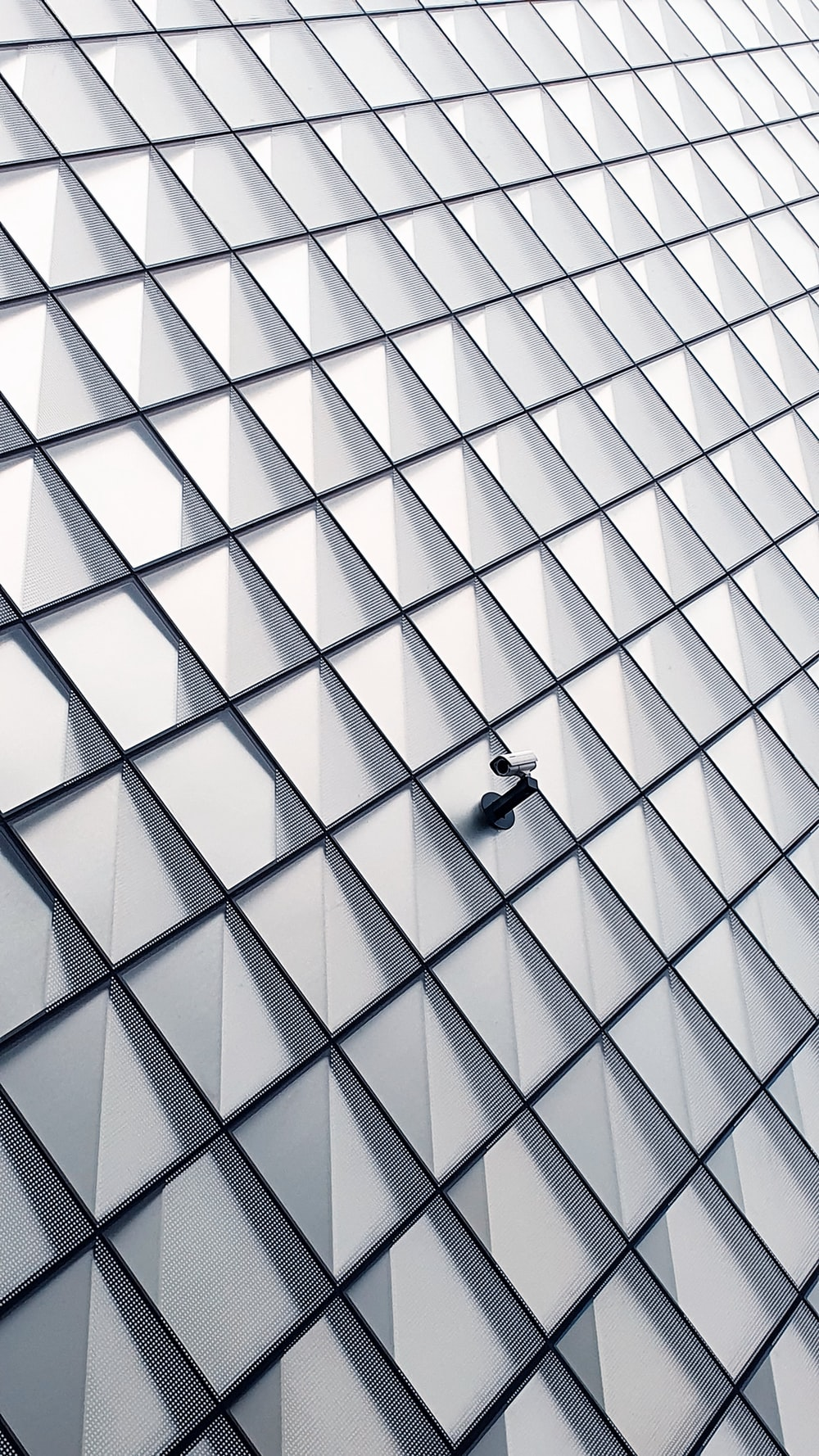 white and black glass walled building