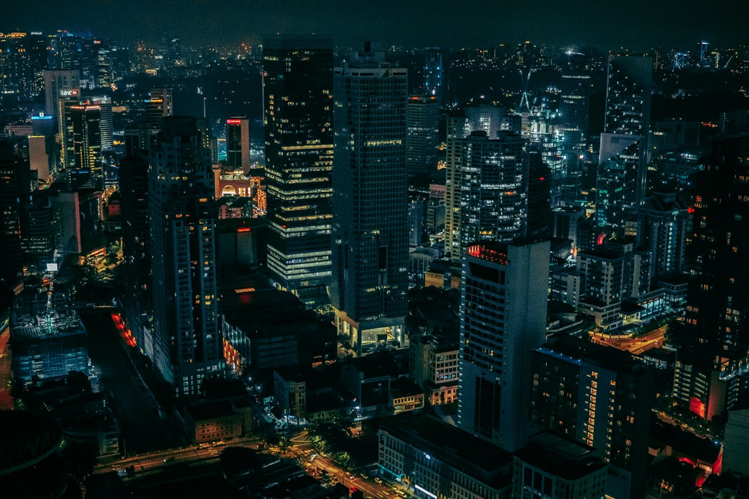 Aerial View of City Buildings During Night Time - unsplash