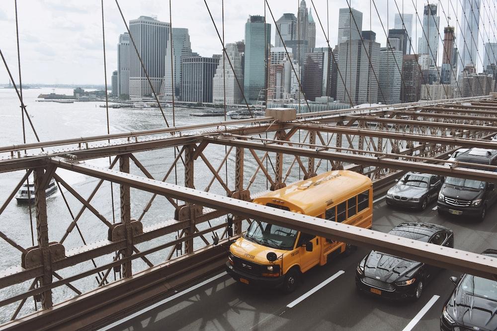 yellow van on bridge during daytime