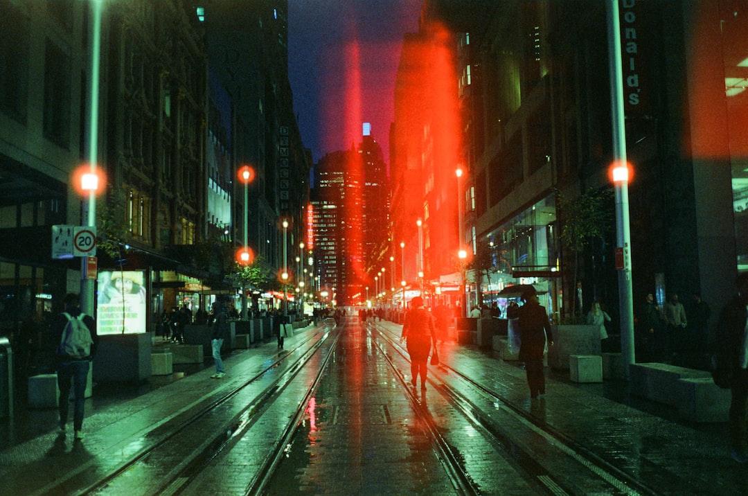 People Walking On Sidewalk During Night Time - unsplash
