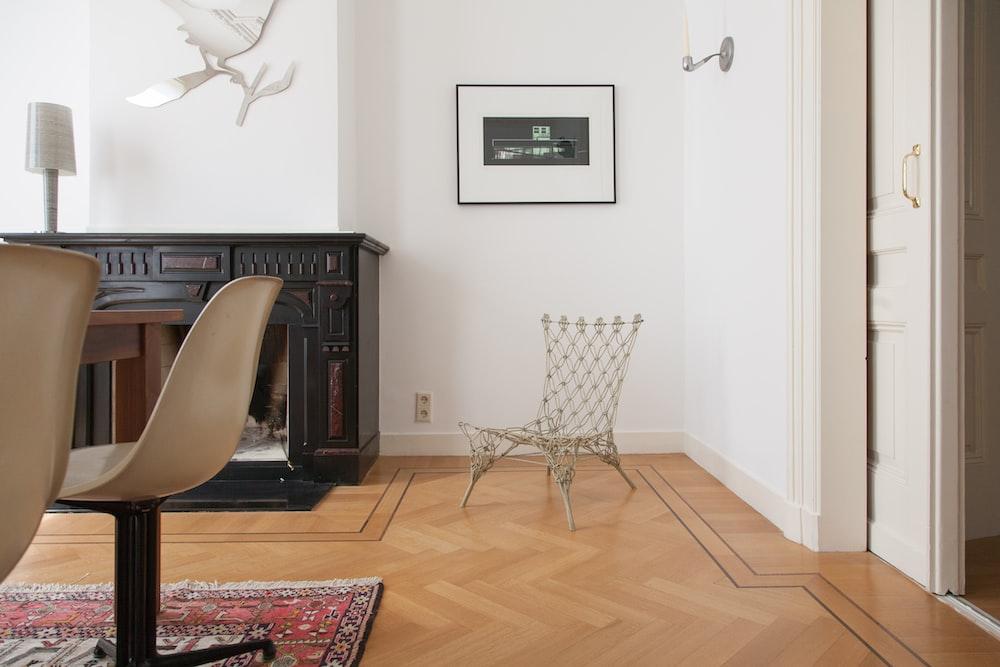 white and black chair near white wall