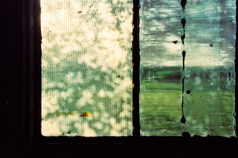 black metal framed glass window