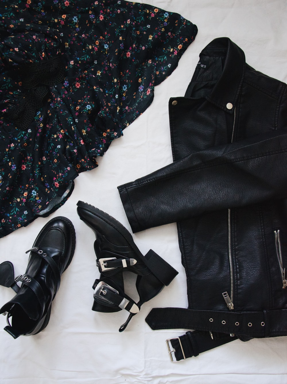 black leather belt on black and white floral button up shirt