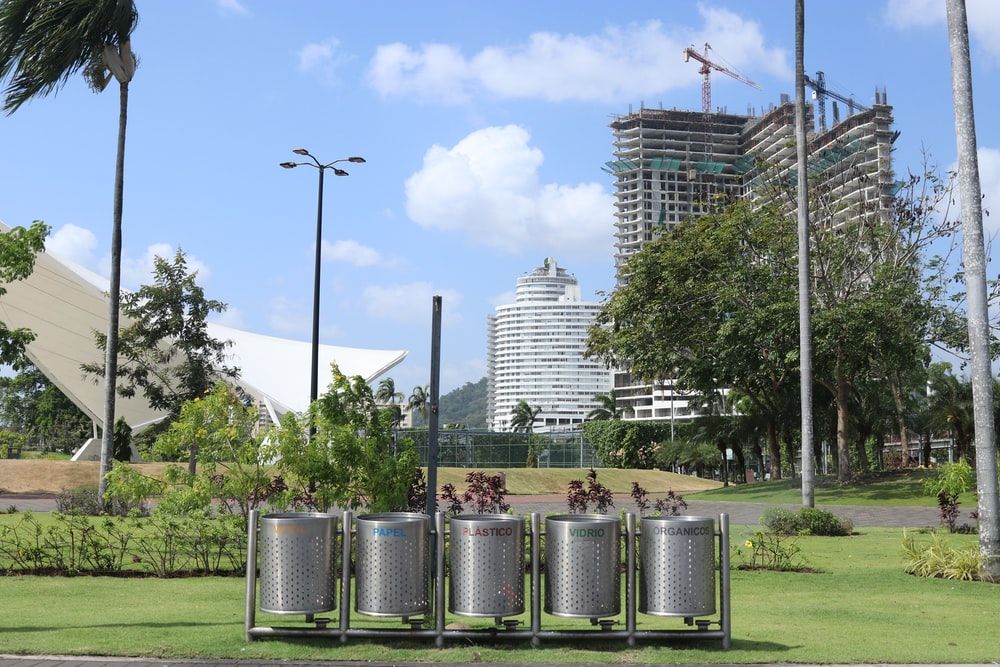 stainless steel trash bins on green grass field during daytime
