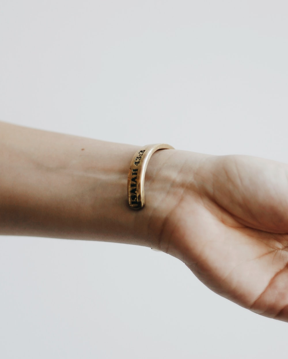 person wearing gold ring with diamond