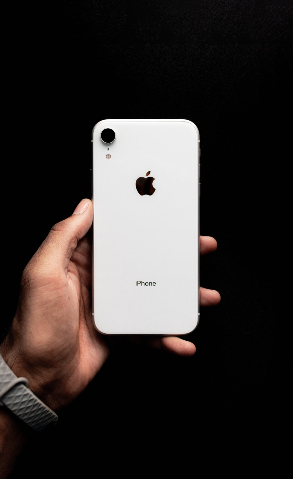 person holding white iphone 4