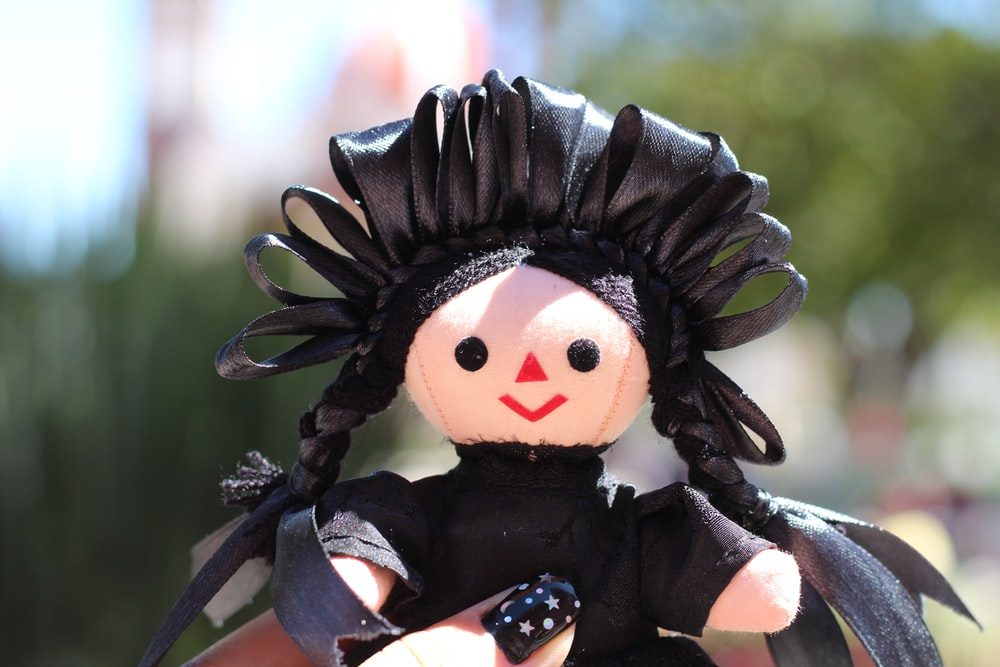 black haired girl in black and white dress doll