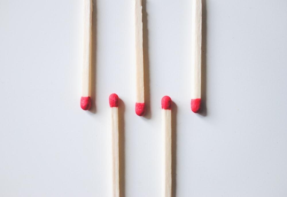 brown wooden sticks on white surface