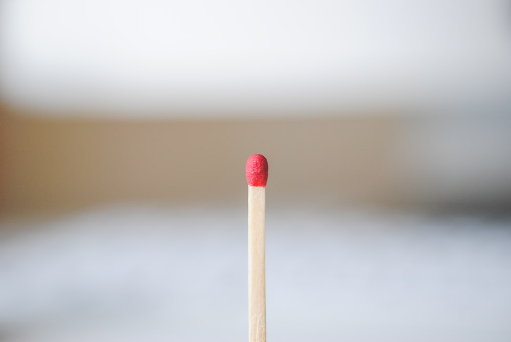 red and white cotton buds