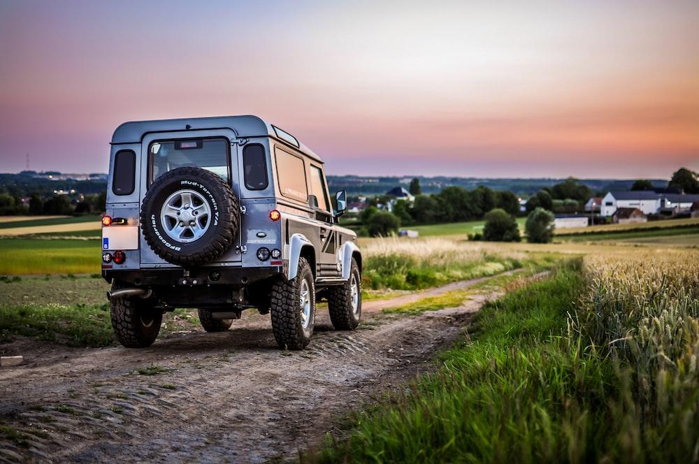 black jeep wrangler on dirt road during daytime