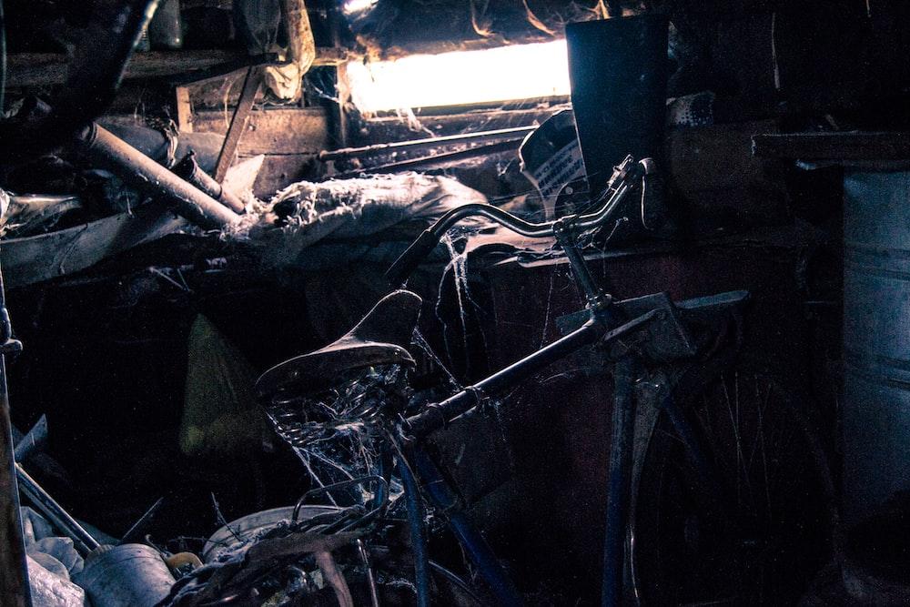 black bicycle near white wall