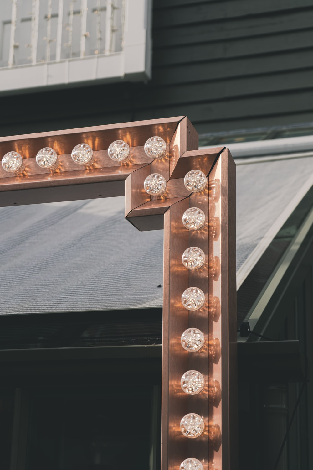 gold and silver round coins on brown wooden shelf