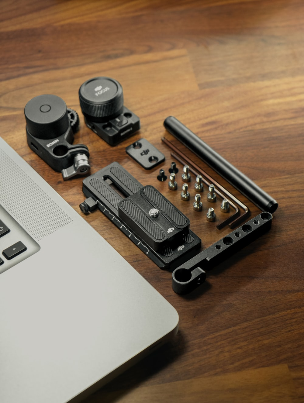 black and silver camera lens beside black and silver laptop computer