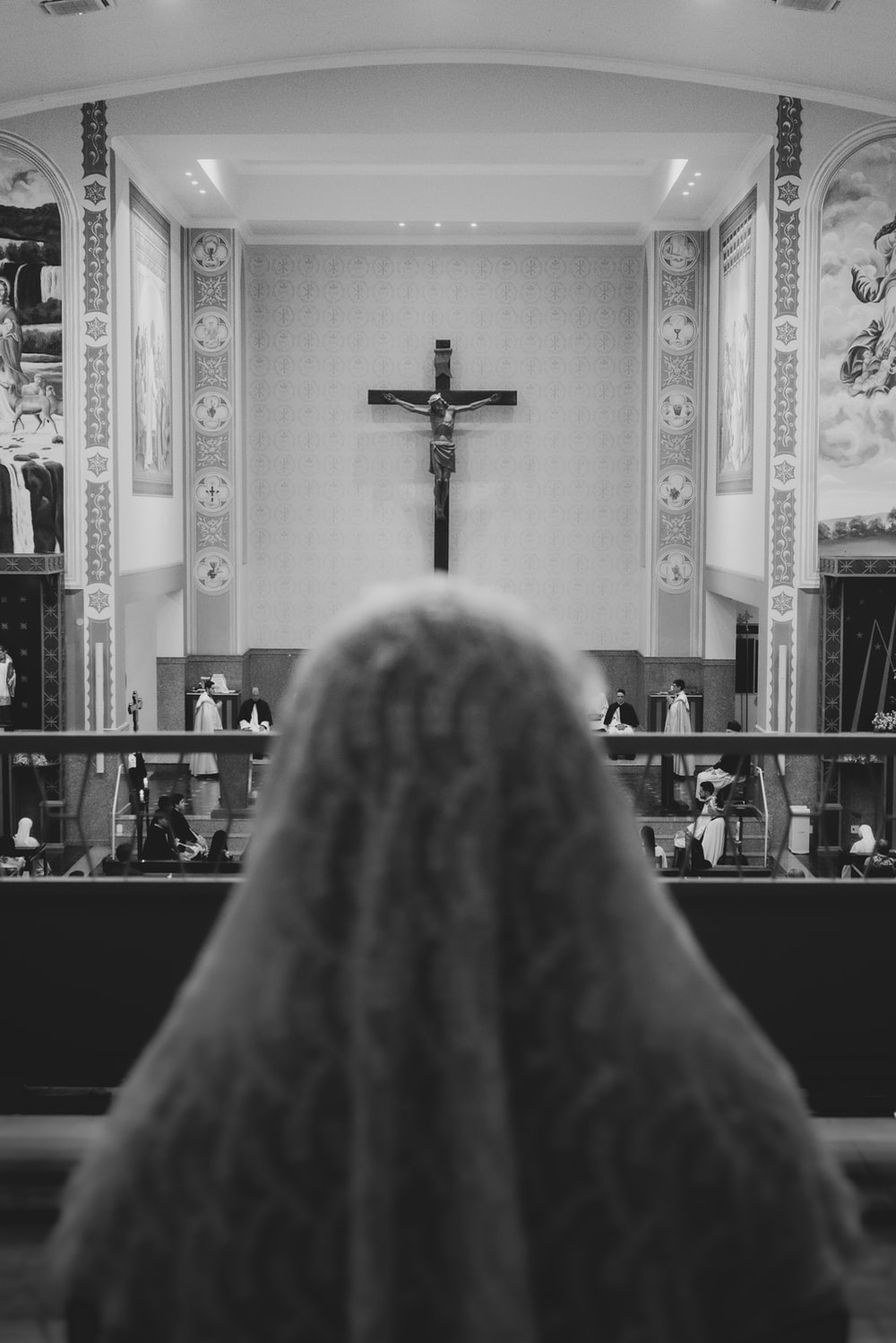 grayscale photo of cross on top of the table