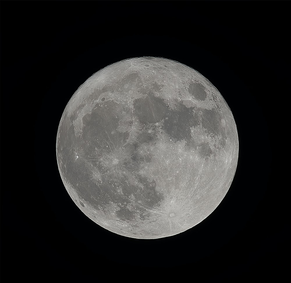full moon in dark night sky