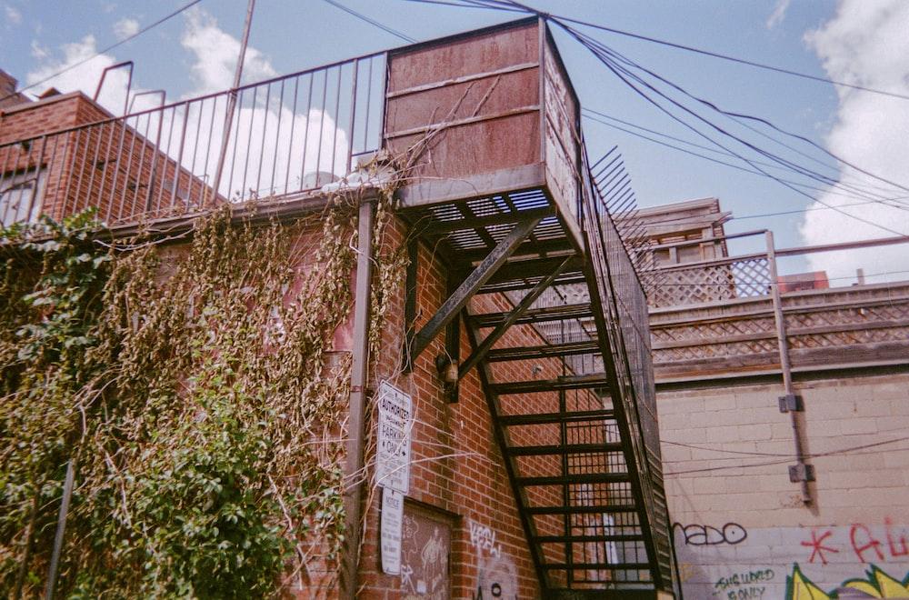 brown wooden ladder on brown brick wall