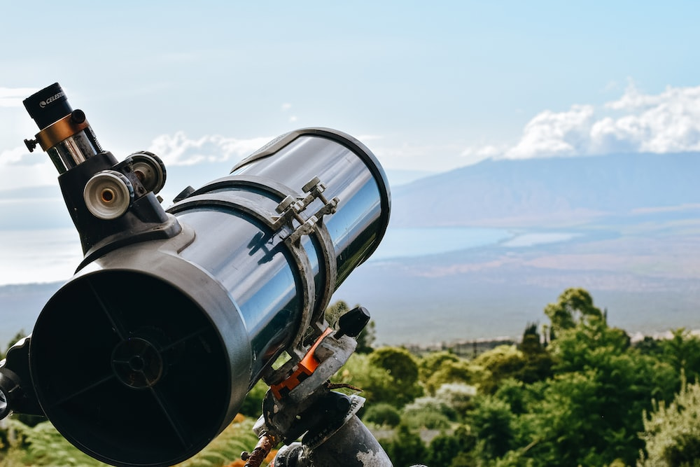 black and silver telescope on green grass field during daytime