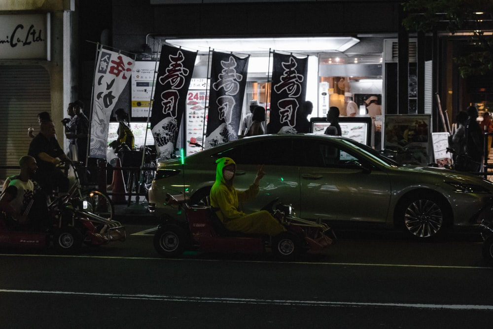 green and black car on street