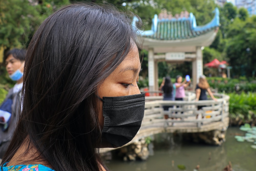 woman with black face mask