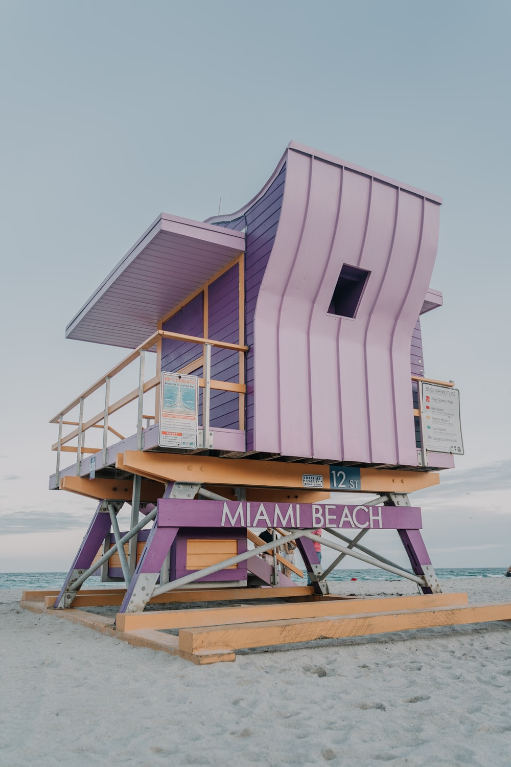 white and brown wooden lifeguard house on beach during daytime