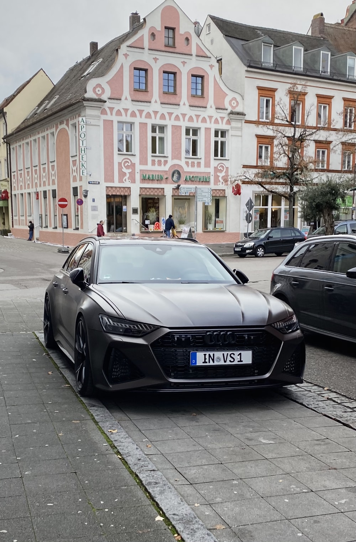 black audi a 4 parked on sidewalk during daytime