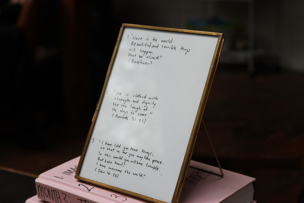 brown wooden framed white board