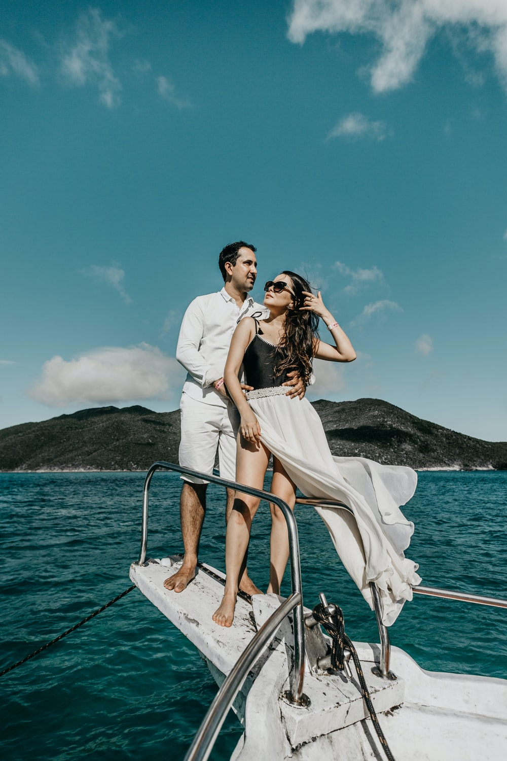 woman in white dress standing on boat during daytime
