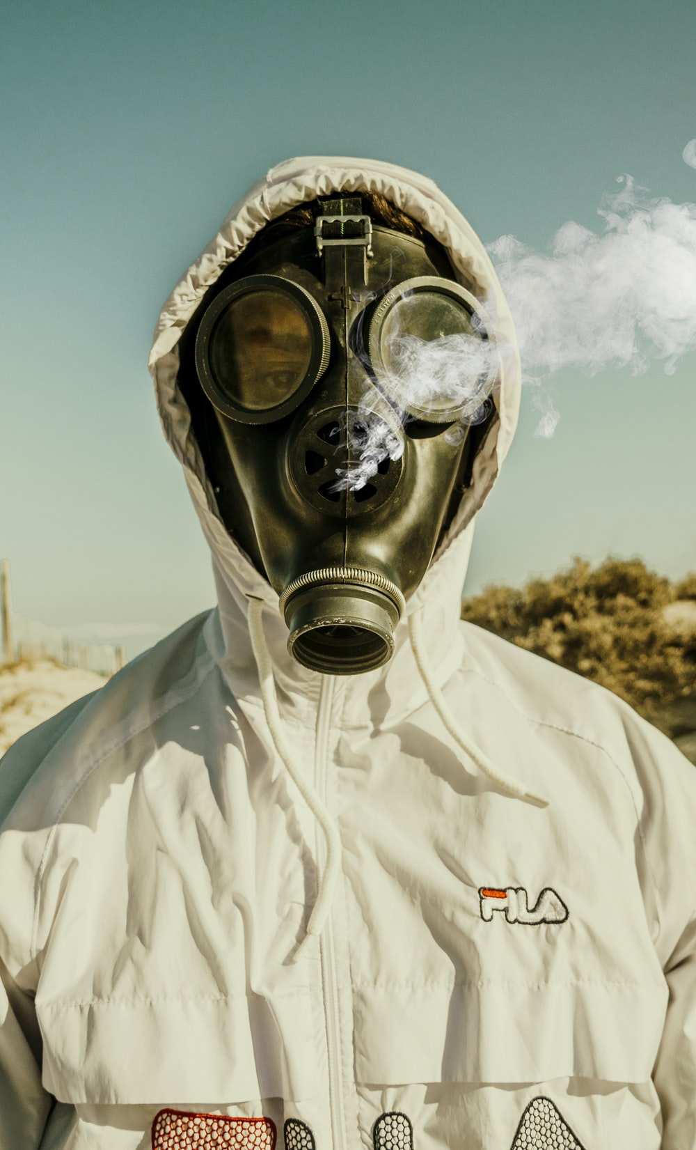 person wearing white and blue gas mask