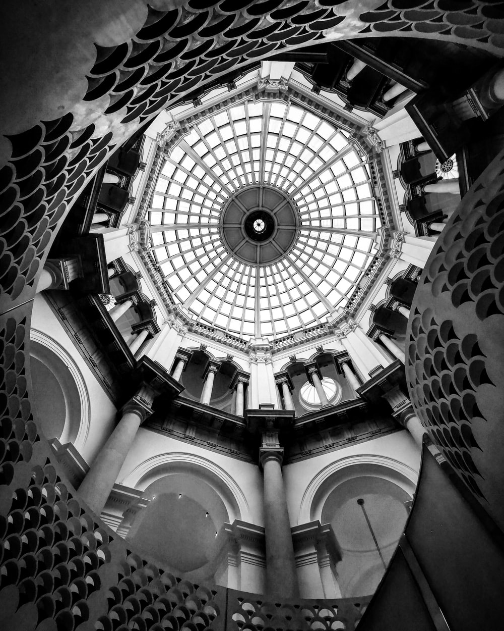low angle photography of white and black dome ceiling