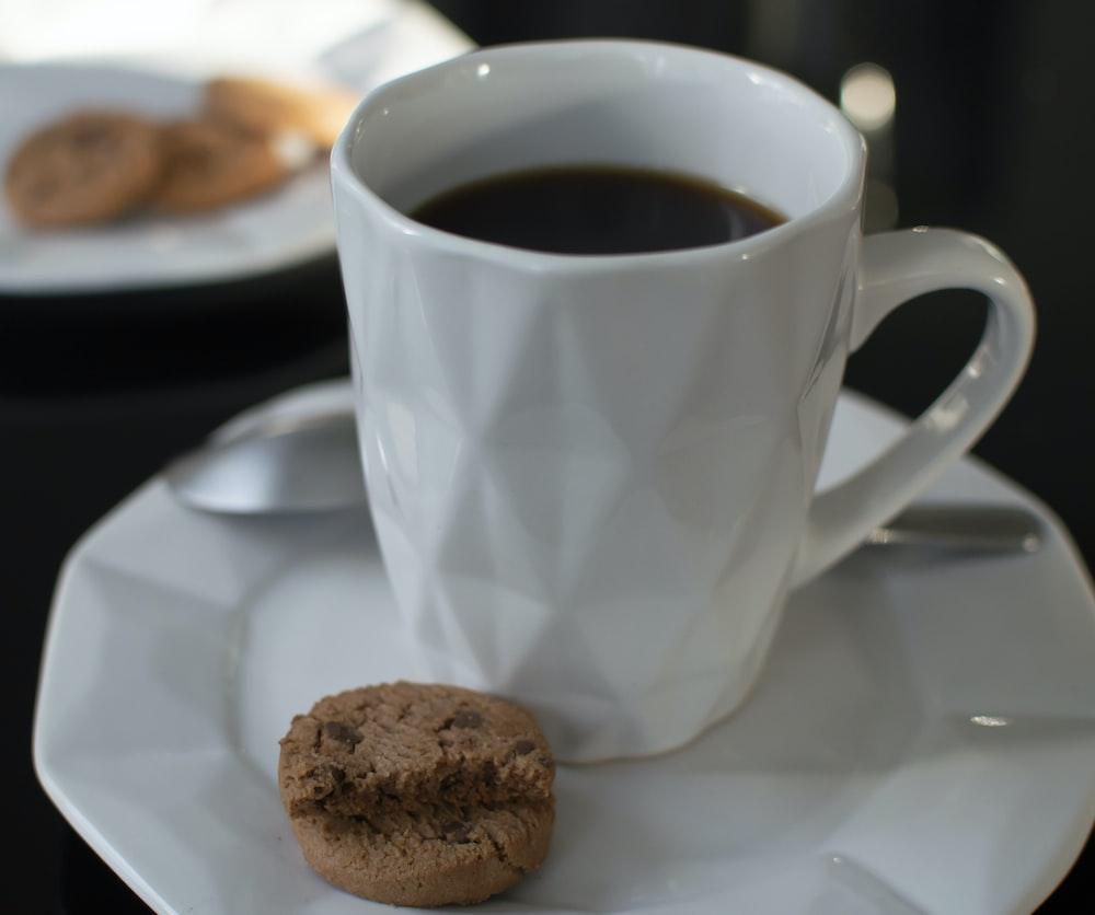 white ceramic mug with black coffee