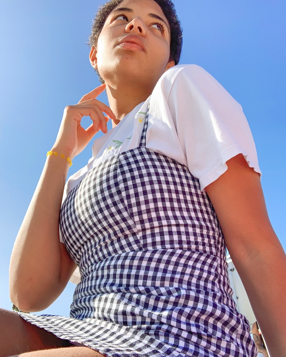 woman in white and black plaid button up shirt